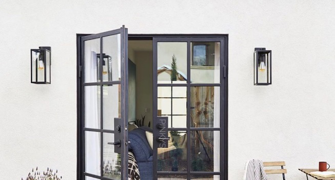 modern iron glass doors opening into a gorgeous patio