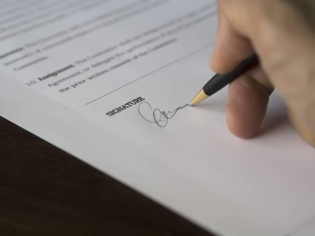 A business man signing a business loan paper