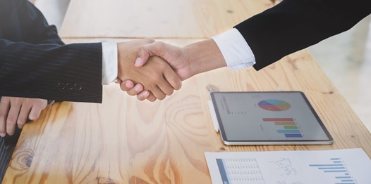 Hotel manager shaking hands with a financing company