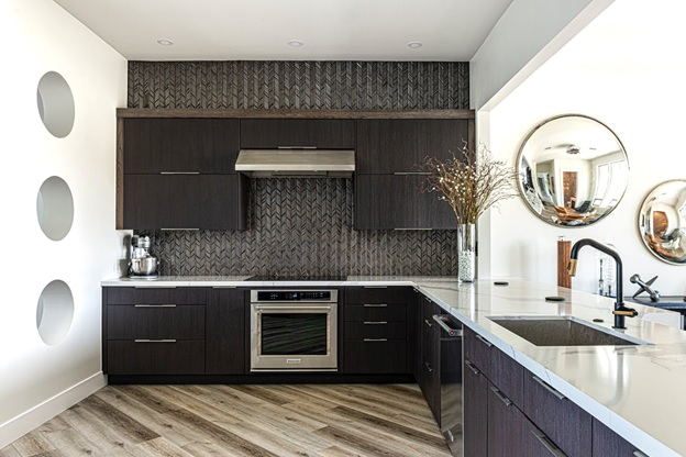 A black and white kitchen with a polished floor