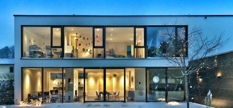 modern house featuring black steel windows and steel sliding doors