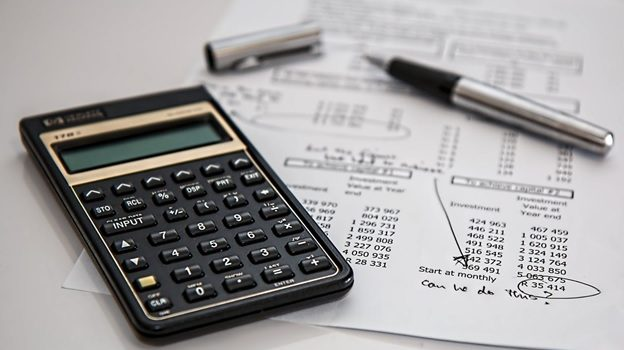 A calculator and a document with numbers