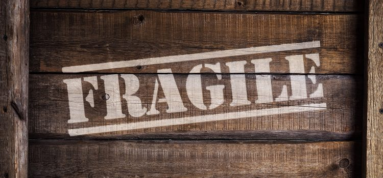 Fragile written over a wooden crate box