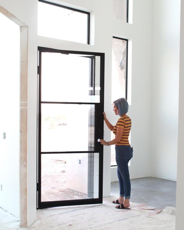 woman testing a new door
