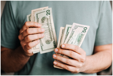 Man with money in his hands