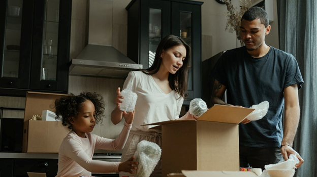 A family moving their personal belongings into a furnished apartment