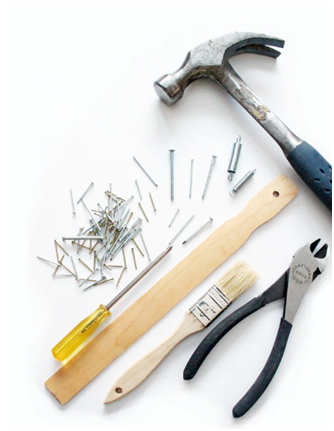 Repair tools such as pliers, a brush, a scale, a screwdriver, a hammer, and some nails for repairs needed after thorough home inspection services in Da