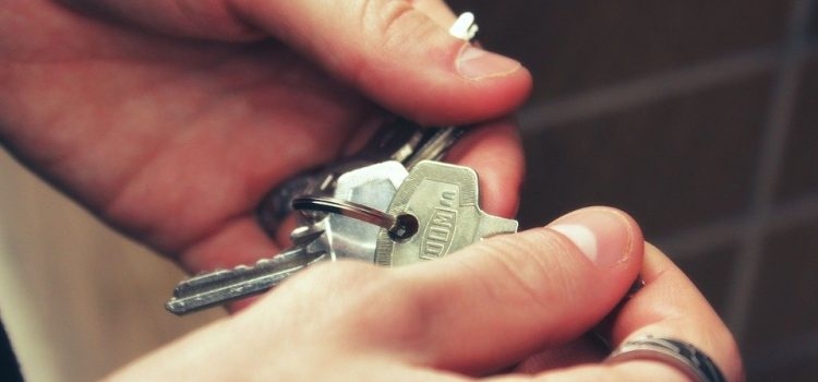 person holding keys to a home