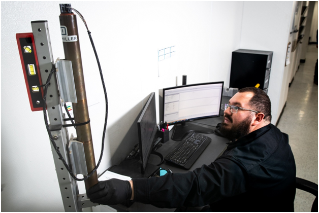 An engineer using the M1 MWD system to extract data in the command center.
