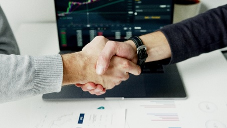 Client and lender shaking hands.