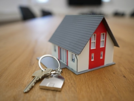 a miniature house on a keychain