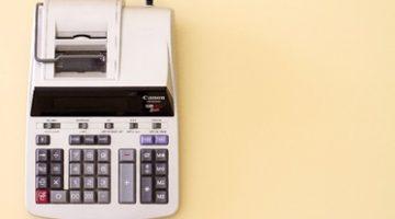 Tax calculator on yellow background.