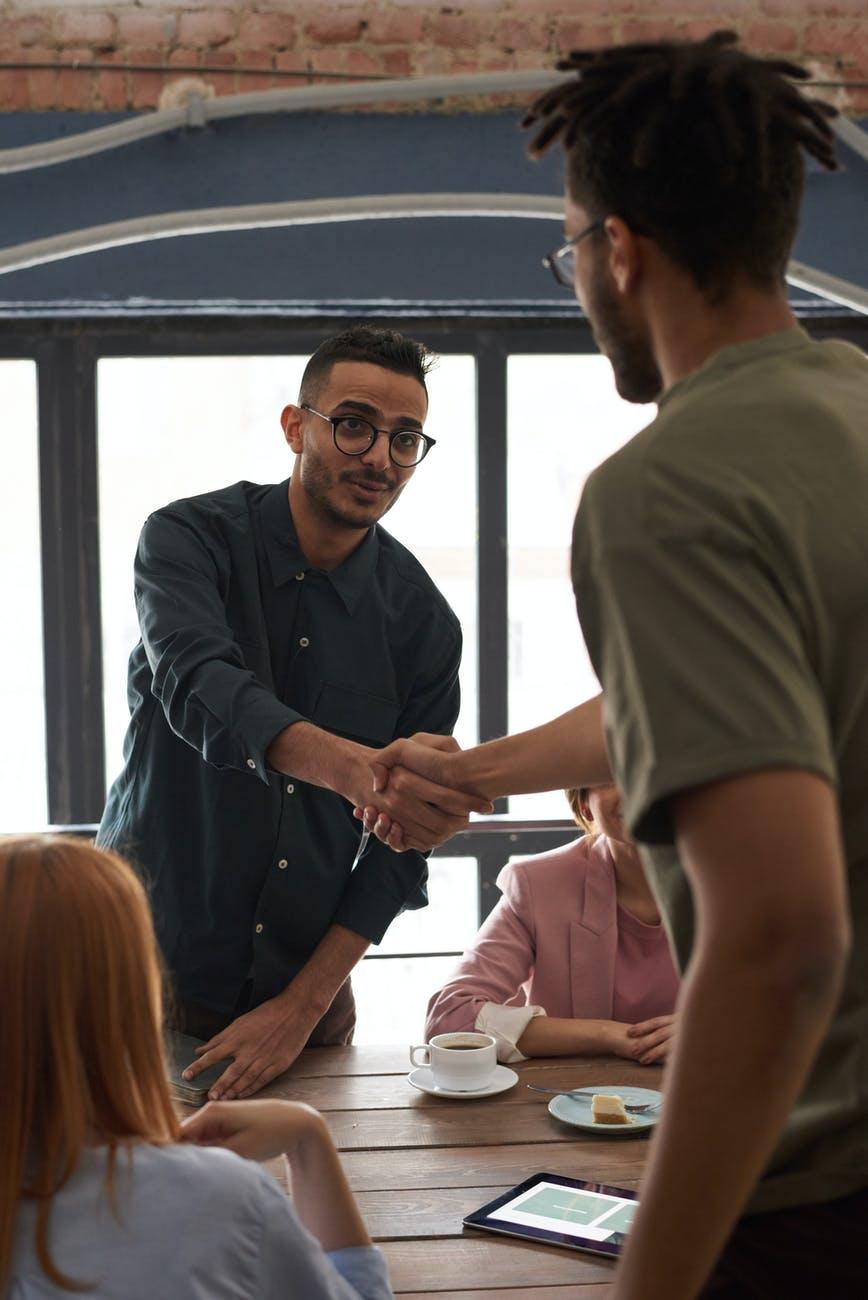 photo of men shaking hands