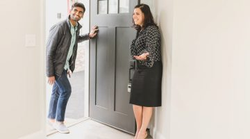 a real estate agent showing property to buyer.