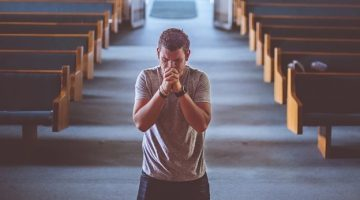 A man praying in church