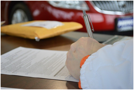 A person filling out a hard money loan application
