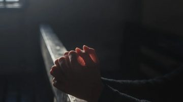 A person praying in church