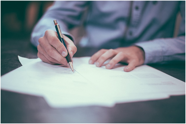 CRE business owner signing a loan agreement
