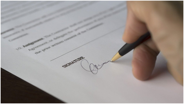 Investor signing an agreement