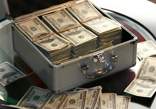Suitcase full of dollar notes