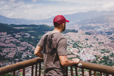 Man enjoying a beautiful view of Medellin from the balcony