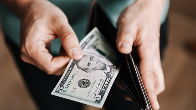 A man takes money out of wallet