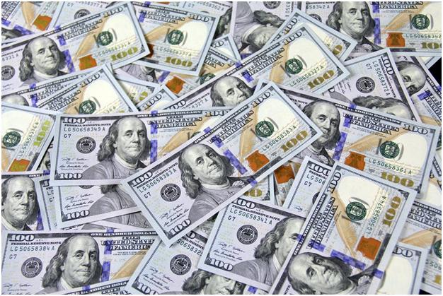 Hundred dollar bills spread out