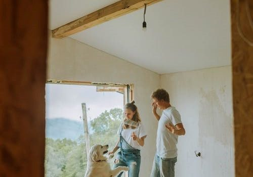 A couple painting their house together.