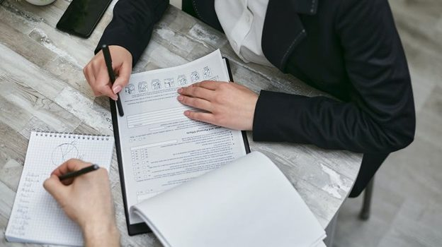 Person signing a loan agreement